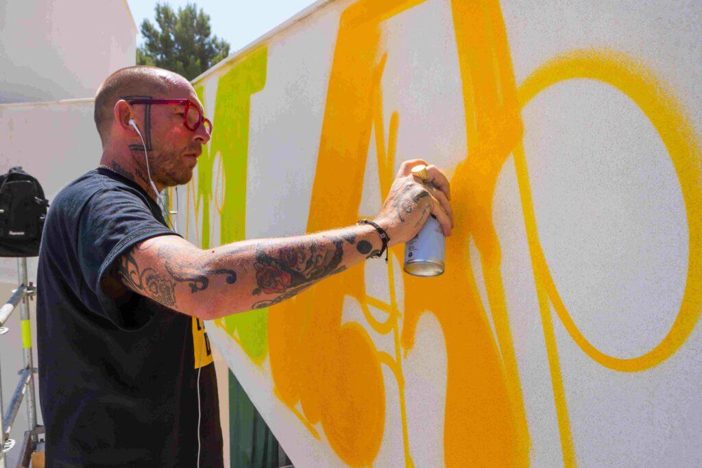 Ben Eine painting mural at 2B Art & Toys Gallery
