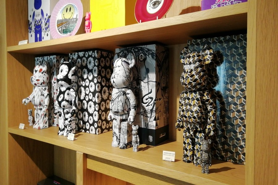 Bearbrick figures on the shelf at 2B Art & Toys Gallery