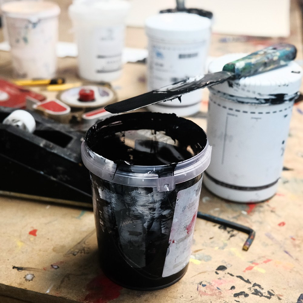 Can of black paint for SheOne's print