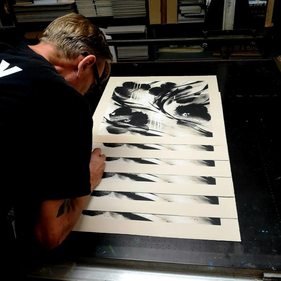 SheOne signing BLCKFLWRS prints
