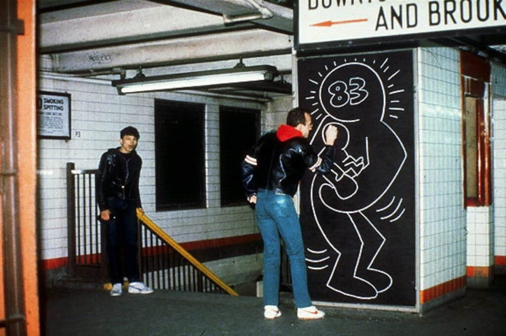 Keith Haring paints in subway